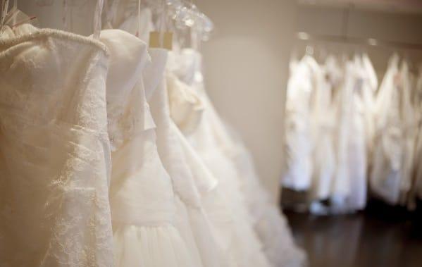 Racks of beautiful donated wedding dresses