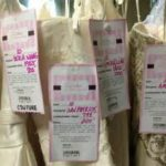 Tags from donated dresses to help breast cancer